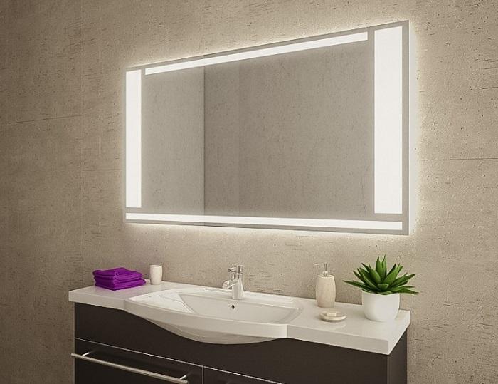 lustro łazienkowe z oświetleniem led nad umywalką z szafką