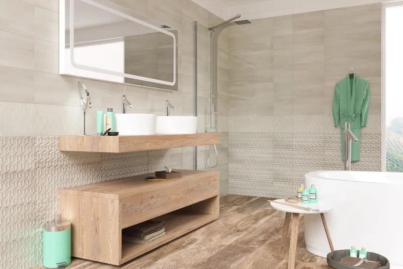 łazienka w stylu skandynawskim, z wanną wolnostojącą oraz umywalkami nablatowymi i znajdującą się poniżej szafką łazienkową